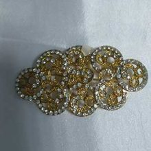 Broche brillantes