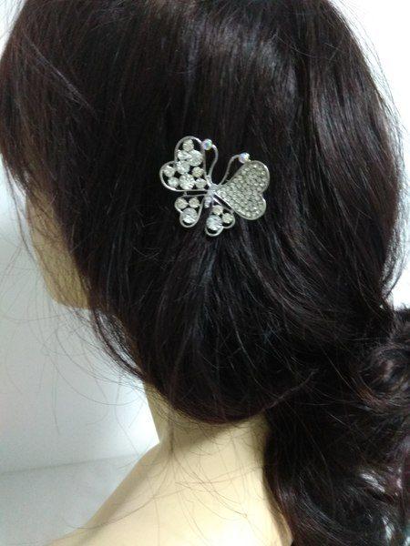 Broche mariposa crista